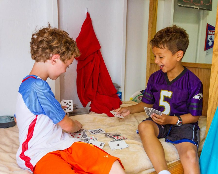 Young Airy campers playing cards in their bunk