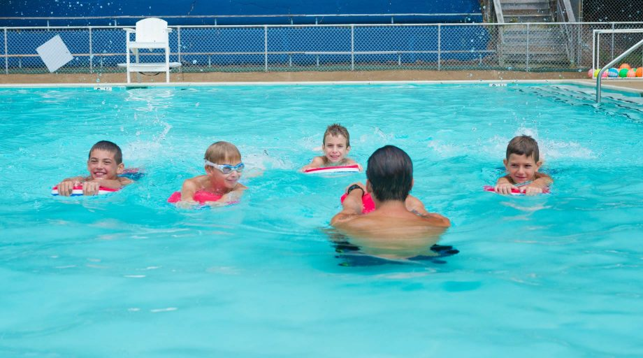 Airy counselor teaching swim