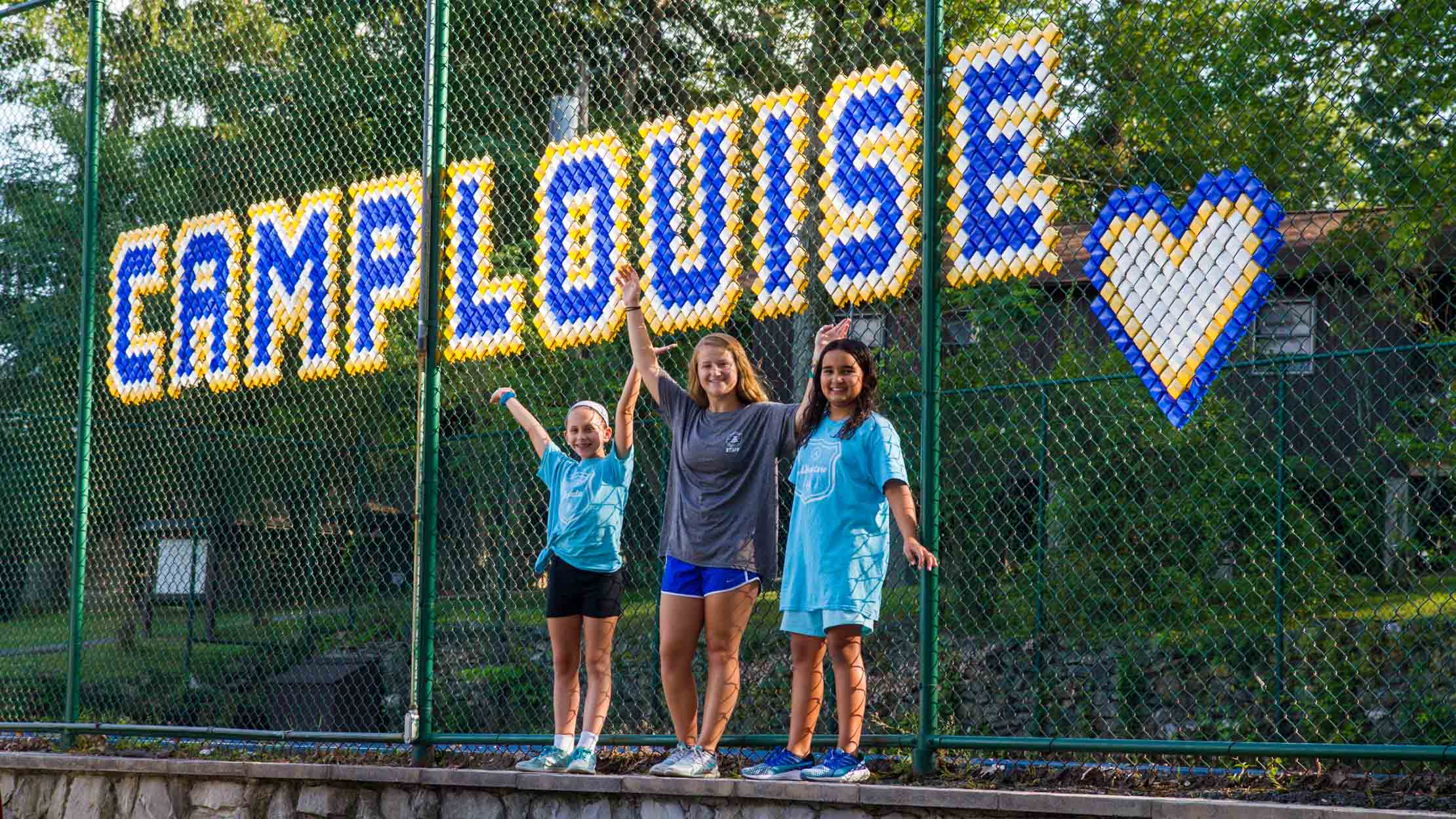 Camp Louise spelled out by tennis court