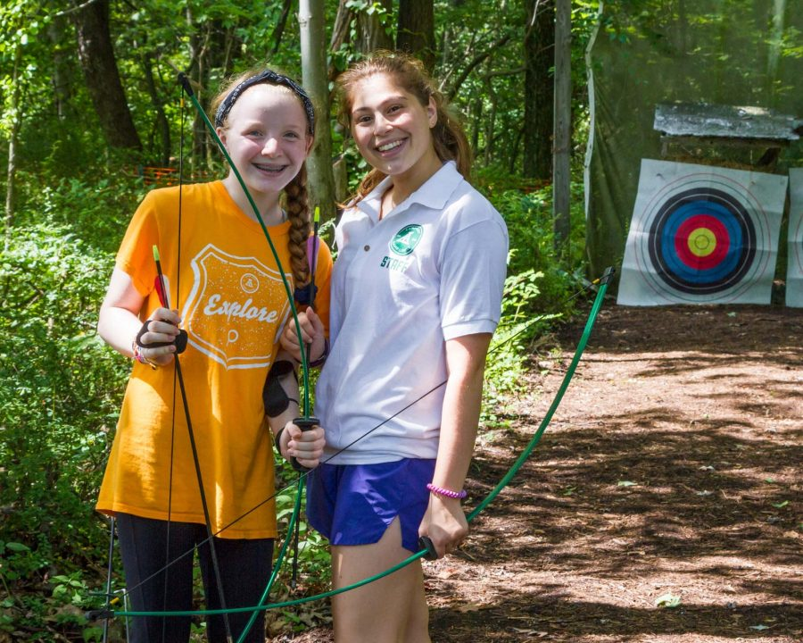 Louise camper and staff at archery