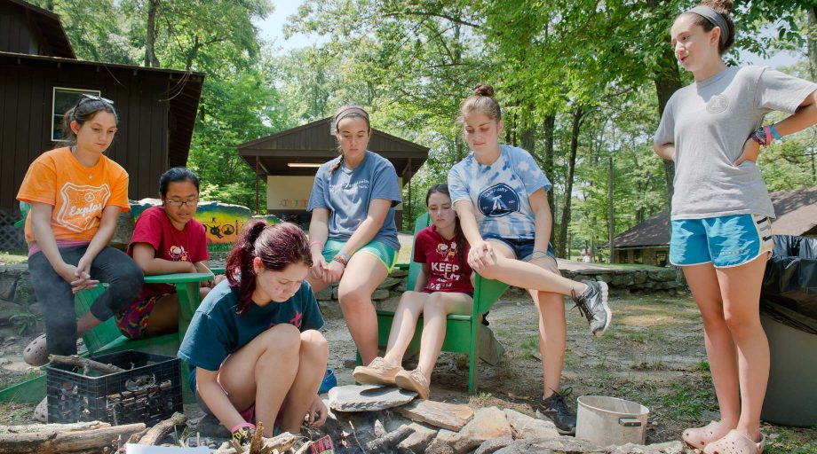 Louise campers learning how to build a campfire
