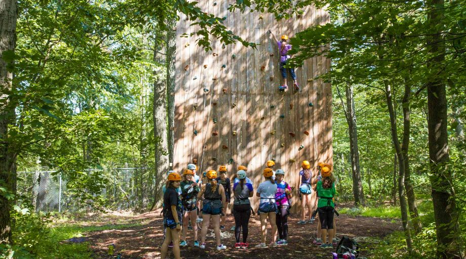 Louise campers on climbing wall
