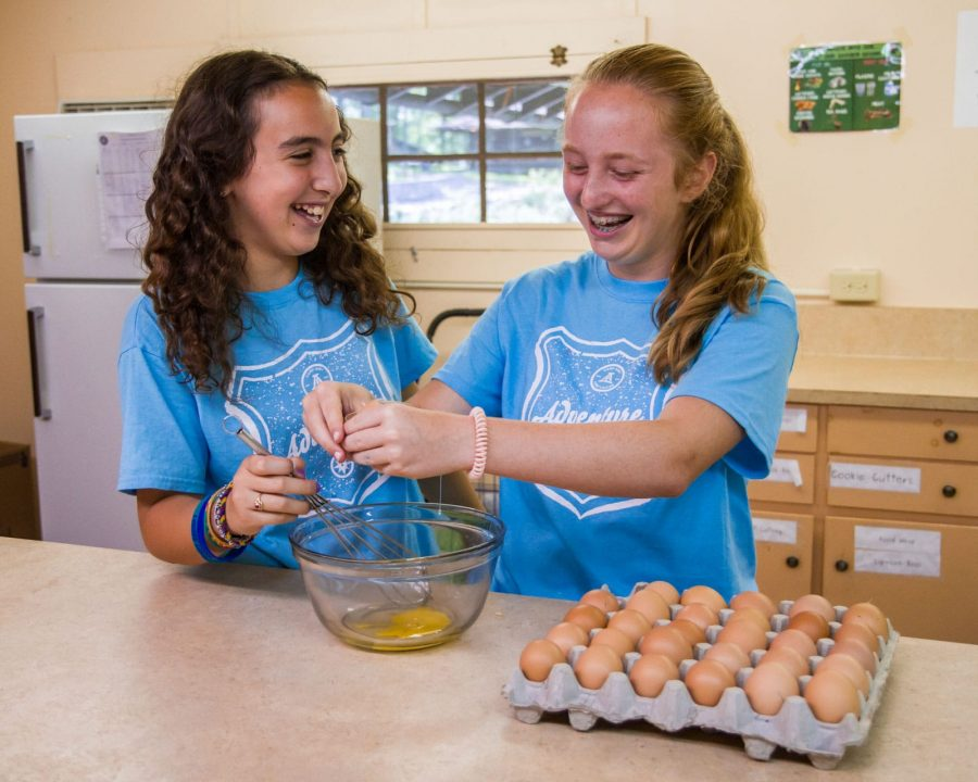 Girls cooking wearing Louise shirts