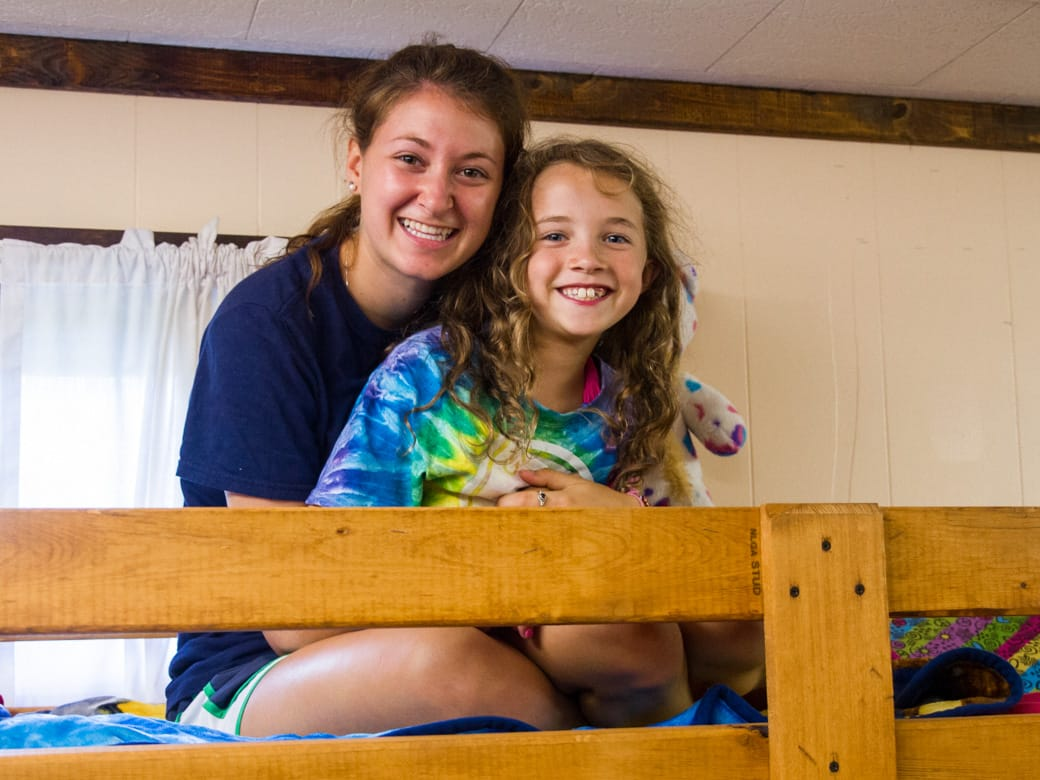 Louise counselor and camper in a bunk
