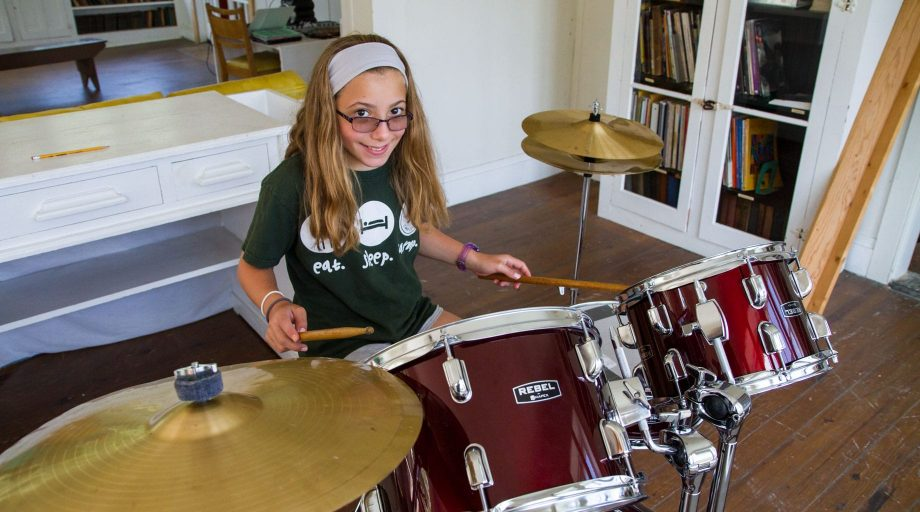 Louise camper playing the drums