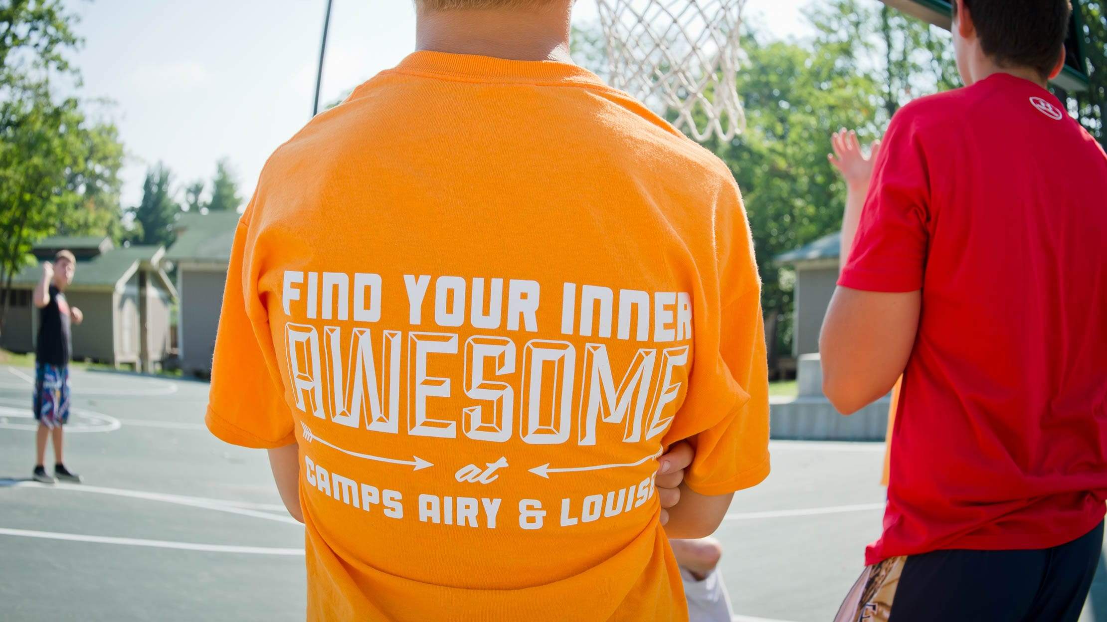 "Camper wearing a ""Find Your Inner Awesome"" shirt"