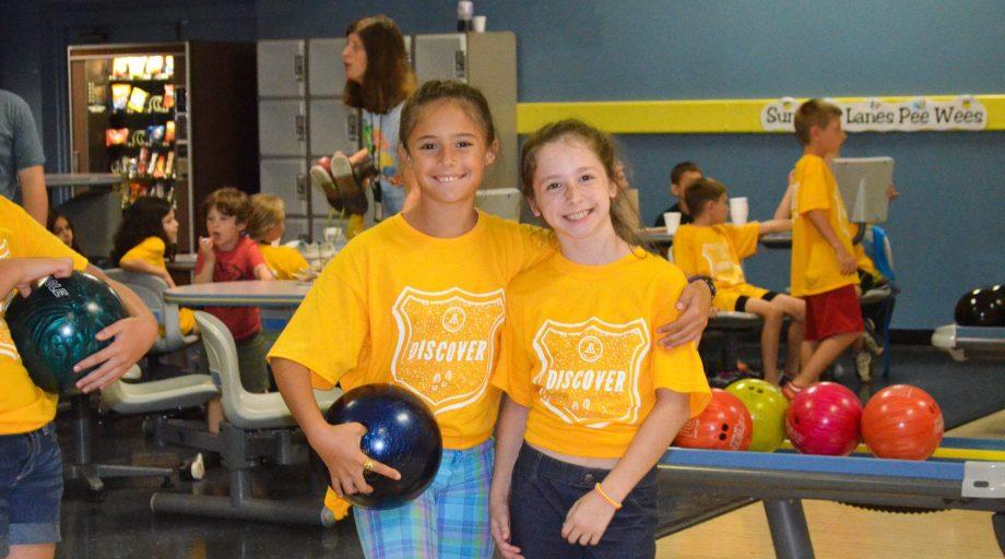 Girls holding a bowling ball