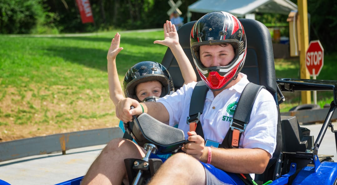 Airy campers driving a go kart