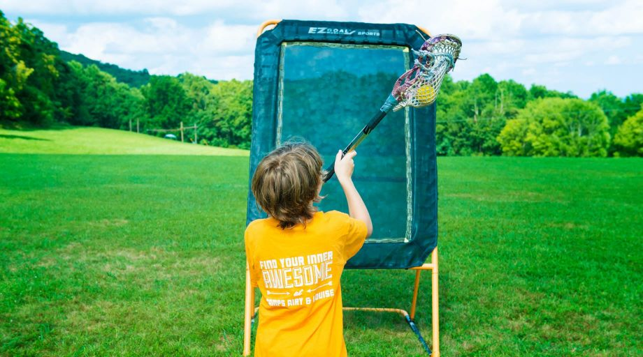 Camper playing lacrosse