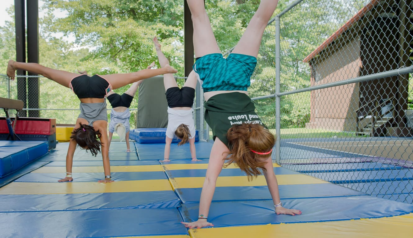 Louise campers doing handstands