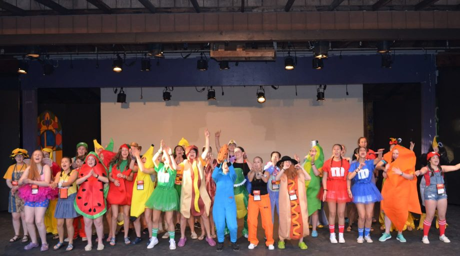 Campers performing on stage