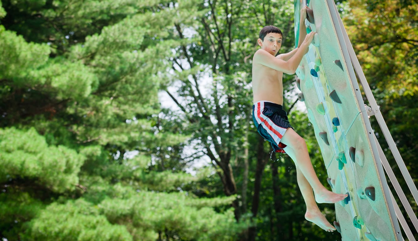 Camper on Airy pool climbing wall