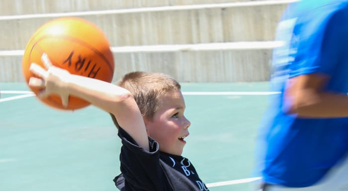 Camper playing basketball at Rookie Camp