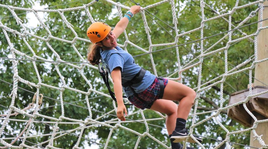 Camper on ropes course