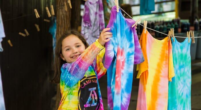 Hanging up tie dye shirts