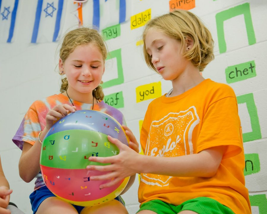 Two Louise campers learning Hebrew